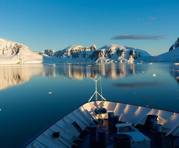 A photo from the bow of a cruise ship sailing through Antarctica