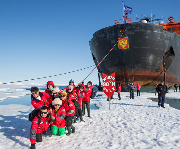 A team of people holding a cruise ship by rope at the north pole